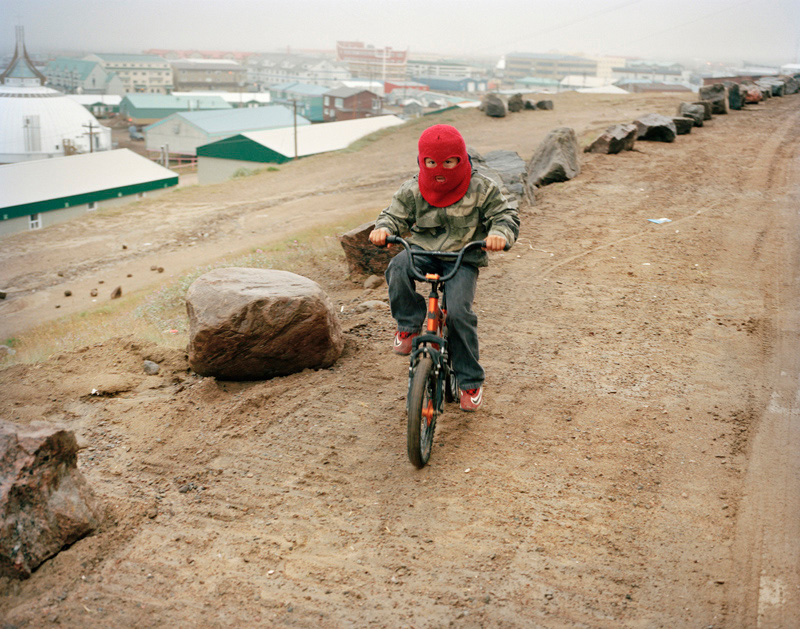 """A kid on a bike, Iqaluit. From the serie """"A Woman With Two Names"""", Vittoria Mentasti."""